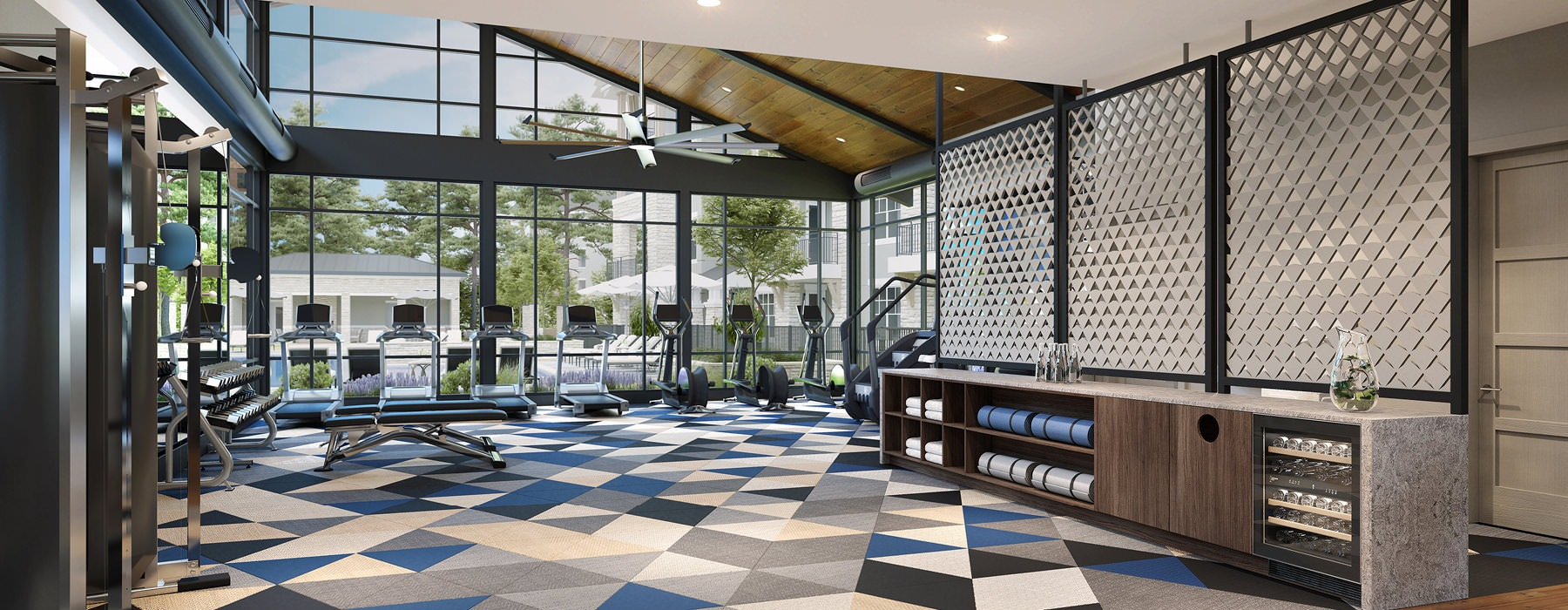 roomy fitness center with floor-to-ceiling windows and large ceiling fans