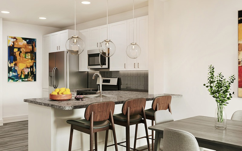 large, kitchen area with pendant lighting above counter adjacent to dining space