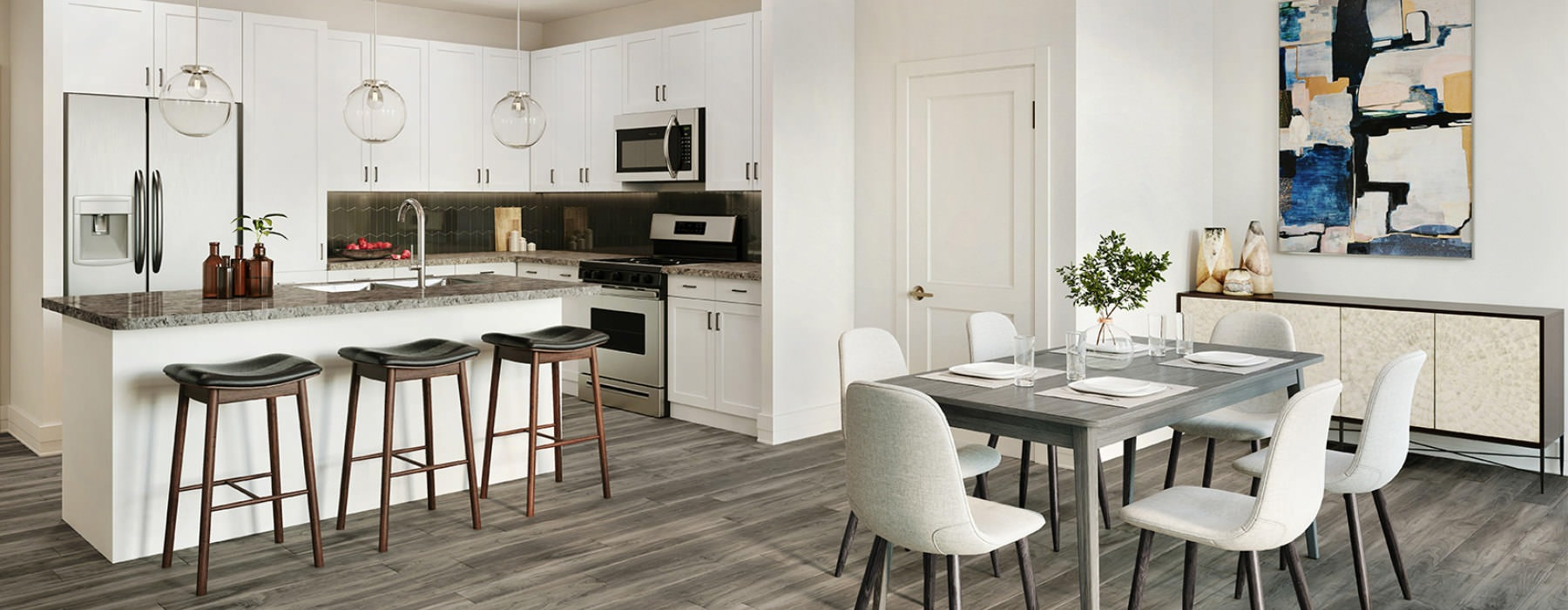 open concept kitchen and dining area with light colored finishes