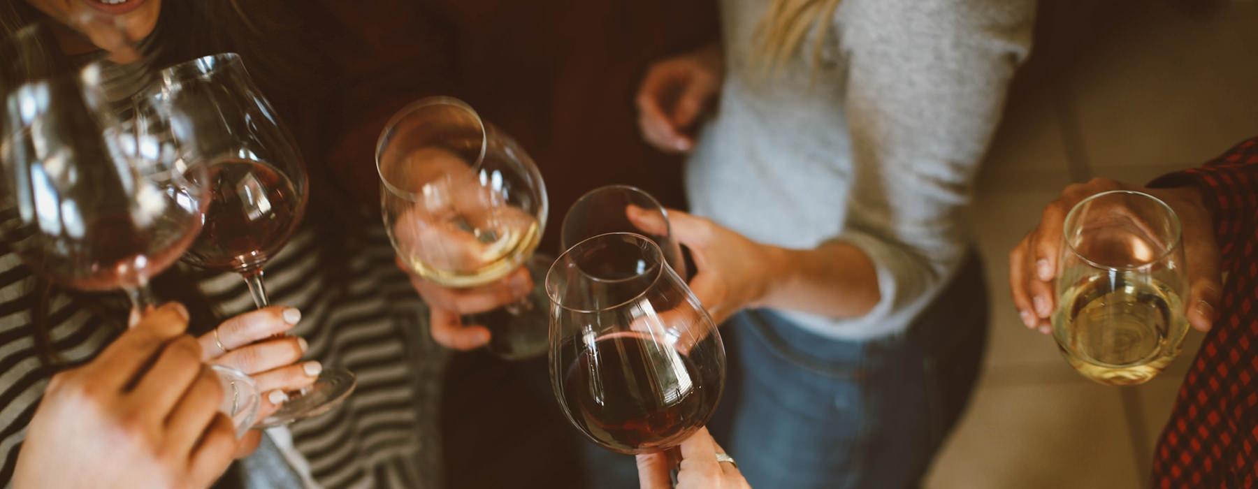 friends enjoying wine in neighborhood restaurant